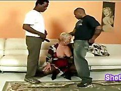 Naughty jaguar Amanda kneels to eat 2 huge black cocks