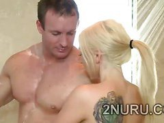 Big stacked blondie seduces hunky perv in the shower