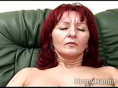 Horny redhead masturbates on the couch while wishing a hefty cock