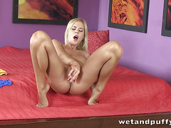 Blonde Noleta pumps her pussy before fucking both holes