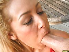 Watch Tinslee suck a big cock as she rubs her big bush.