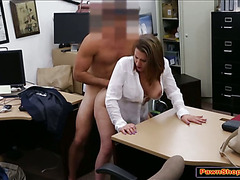 Busty business minded MILF gives a bj