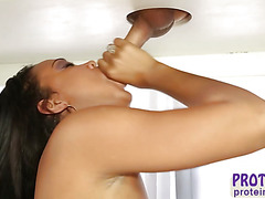 Milking maid Harley Dean receives cum facialed after sucking her client cock
