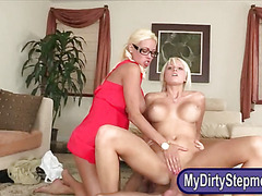 Two busty women share a huge hard cock