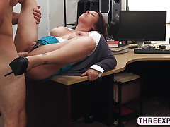 Matured brunette MILF strips her shirt and shows her big juicy tits in the pawnshop