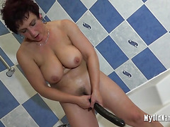 Big breasted mature woman with dildo