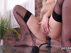 Adorable nympho is peeing and rubbing smooth snatch