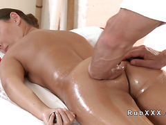 Oiled brunette hottie rode masseurs cock