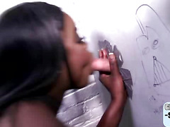 Busty black whore takes on big dicks in the glory hole