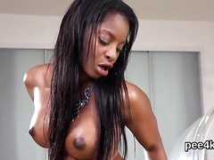 Breathtaking sweetie is peeing and rubbing smooth fuckbox