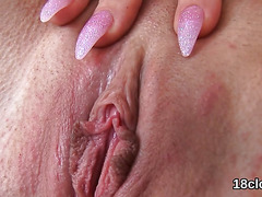Fervent sweetie is gaping narrow cunt in close-up and climaxing
