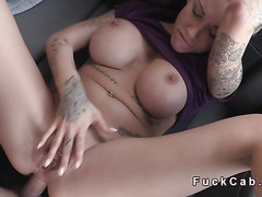 Tattooed blonde anal banged in fake taxi