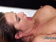 Busty chick pees and gets pounded