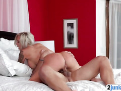 Hot blonde stepmom enjoys big cock on bed