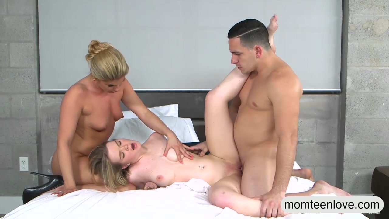 Hot Threesome On A Bed
