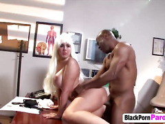 Platinum blonde with huge tits seduces and fucks black guy in his office