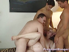 Orgy with a pregnant mature and three men