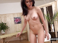 Breathtaking sweetie is peeing and pleasing trimmed snatch