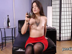 Ravishing cutie is peeing and pleasuring trimmed snatch