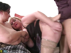 Three amateur mature ladies sharing a young stud