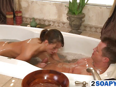 Hot brunette masseuse giving a blowjob and handjob in a bath tub