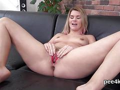 Ravishing chick is pissing and masturbating shaven vulva