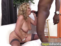 Insatiable mature slut is playing with a big black rod until it explodes and covers her with cum