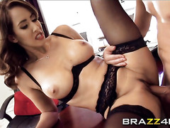 Stunning busty MILF Isis Love is riding a big cock in a hardcore sex
