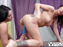 Lesbians Camilla and Lucia pissing in mouths
