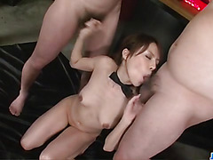 Rino Asuka is surrounded by several tasty cocks