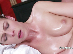 Oiled babe gets pussy massaged and banged