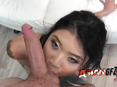 Tattooed Asian blowing fat cock