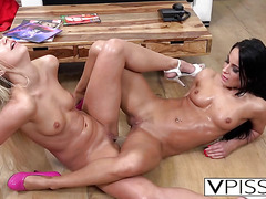 Slutty lesbians pissing and scissoring on floor