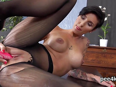 Ravishing sweetie is pissing and fingering smooth honey pot