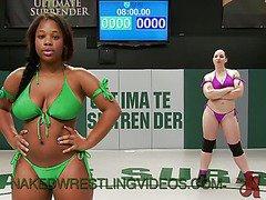 Interracial lesbian wrestling match on mats