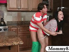 MILF stepmom catches teen couple fucking in the kitchen