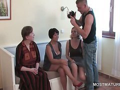 Foursome with mature lusty babes and teen stud