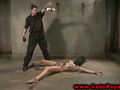 Tied up sub faces hot wax and clamps