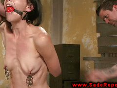 Tied up submissive gets whipped