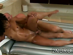 Gorgeous black hottie gives hot massage and gets her coochie split
