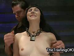Brunette slave on wooden horse zippered
