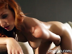 Gorgeous red hair babe Michelle stripped off and fingering herself