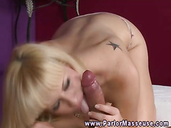Blonde fills mouth on cock during massage session