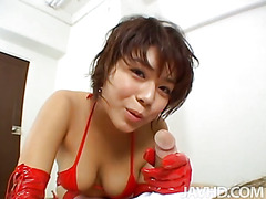 Kinky Luna in red latex and fishnet stockings gives a footjob