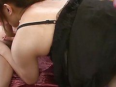 Kinky Mami Asakura gives her guy a foot job until he splits her pussy doggie-style