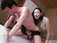 Kaori Akitsu sits on a guys lap and then uses her feet to stroke and kick her lovers ass