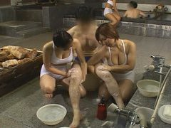 Busty bath house babes clean clients exposed cock