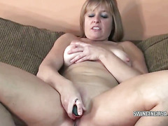 Mature blonde housewife Liisa uses her big red dildo to fuck her dripping wet pussy