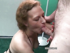 Petite redhead MILF Anna in a string bikini and on her knees to swallow a stiff cock