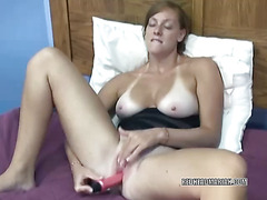 Busty redhead Mariah uses a toy to make herself cum